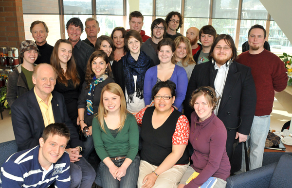 John Ralston Saul (sitting on the left & wearing a yellow shirt) poses for a photo with students, instructors and others who had the opportunity to sit and informally chat with him the morning of Thursday April 1.