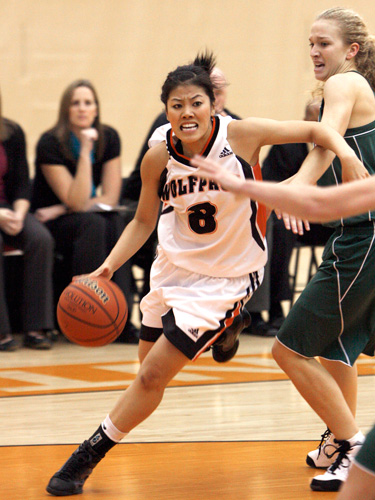 Jen Ju, point guard, carries the ball up the floor in Women's Basketball action. Jen is a second year Journalim student at TRU.