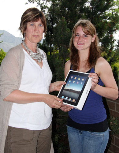 Arlene Olynyk, TRU Alumni Officer, presents Erin her prize, a new Apple iPad