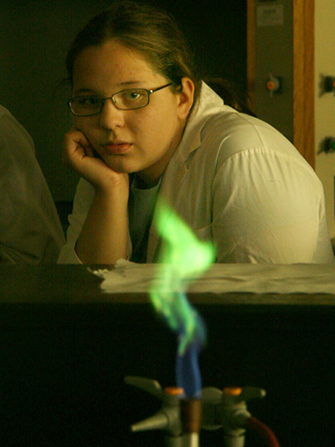 Kayla, from Kamloops,  is absorbed by the demonstration showing the principle behind fireworks. Students were shown how a flame displays a different colour depending on the metal compound sprayed into the flame. In this case, copper was the compound.