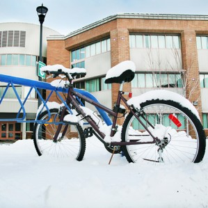 Snow-covered bike on campus