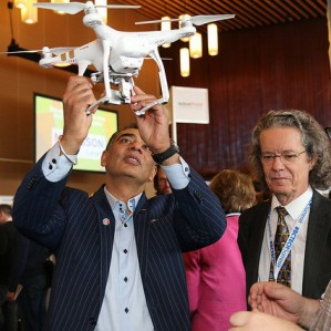 Minister of Technology and Citizens Services, Amrik Virk, along with TRU President Dr. Alan Shaver, take an interest in the UAVs being used by Dr. John Church in his precision ranching research project.