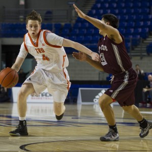 Returning plater Jeff Tubbs drives on his defender at the CIS National Championships.