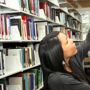 Student looking at books in the library