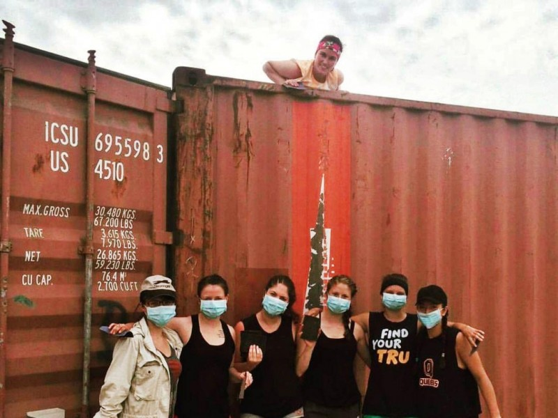 Science alumni Carlee Poleschuk and Katie Sparrow building houses out of shipping containers in Ecuador.