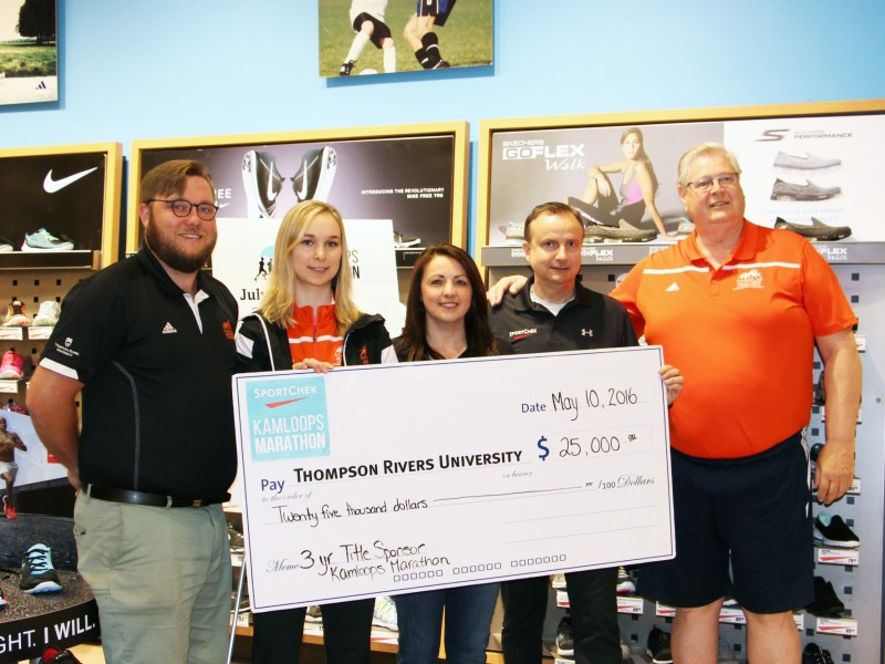 Sport Chek presents a cheque for a three-year title sponsorship of the Kamloops Marathon.