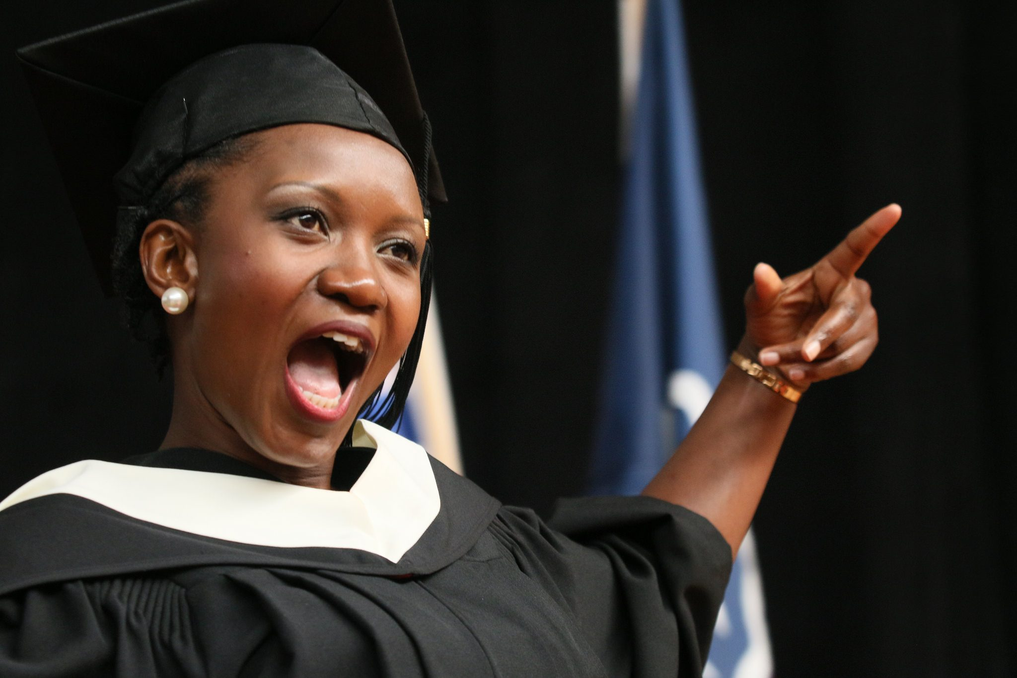 Convocation arts student cheer on stage