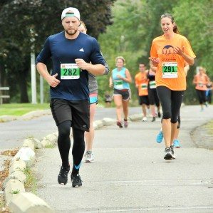Racers in the 8km category make their way through McArthur Island Park during the 2015 Kamloops Marathon.