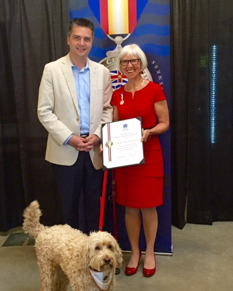 Trudie Bonbernard, right, and her therapy dog Skye with BC Minister of Transportation Todd Stone.