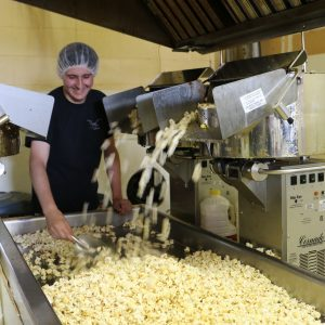 Business grad, Cody Inskip on the popcorn production line.