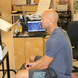 MEd student Brett Wasylik tests out the EEG machine.
