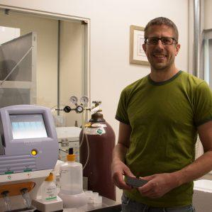 TRU biologist Dr. Jonathan Van Hamme explains genome sequencing machines to Geneskool students.