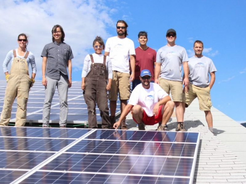 Members of the group that helped to install the solar panels.