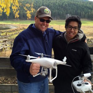 Dr. John Church, BC Regional Innovation Chair in Cattle Industry Sustainability, with Bachelor of Science student Justin Mufford, are using drones to observe calves immediately following castration to identify behaviours that indicate pain. (Photo courtesy CBC/Daybreak)