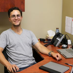 Nick Saxby at his desk in the United Way offices