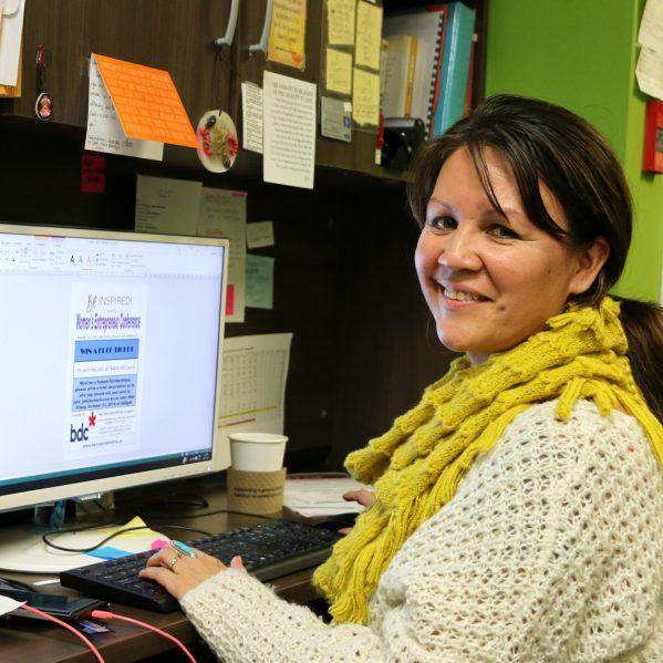 TRU Alumna, Julie John, at her desk, in her store—Eagle Eye—First Nations Gifts