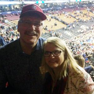 Open Learning alumna Janet MacMillan and her husband at the Raptors game.