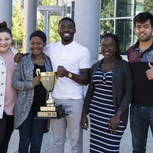 From left to right: MBA students Tanisha Suzuki, Fatimah Abdullahi, Tomi Owoyemi, Jessica Mamman and Himanish Raghunath with the BC MBA Games trophy