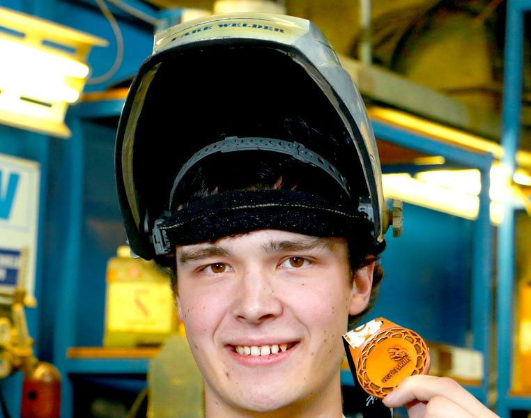 Andrew Christensen with WorldSkills medal of excellence