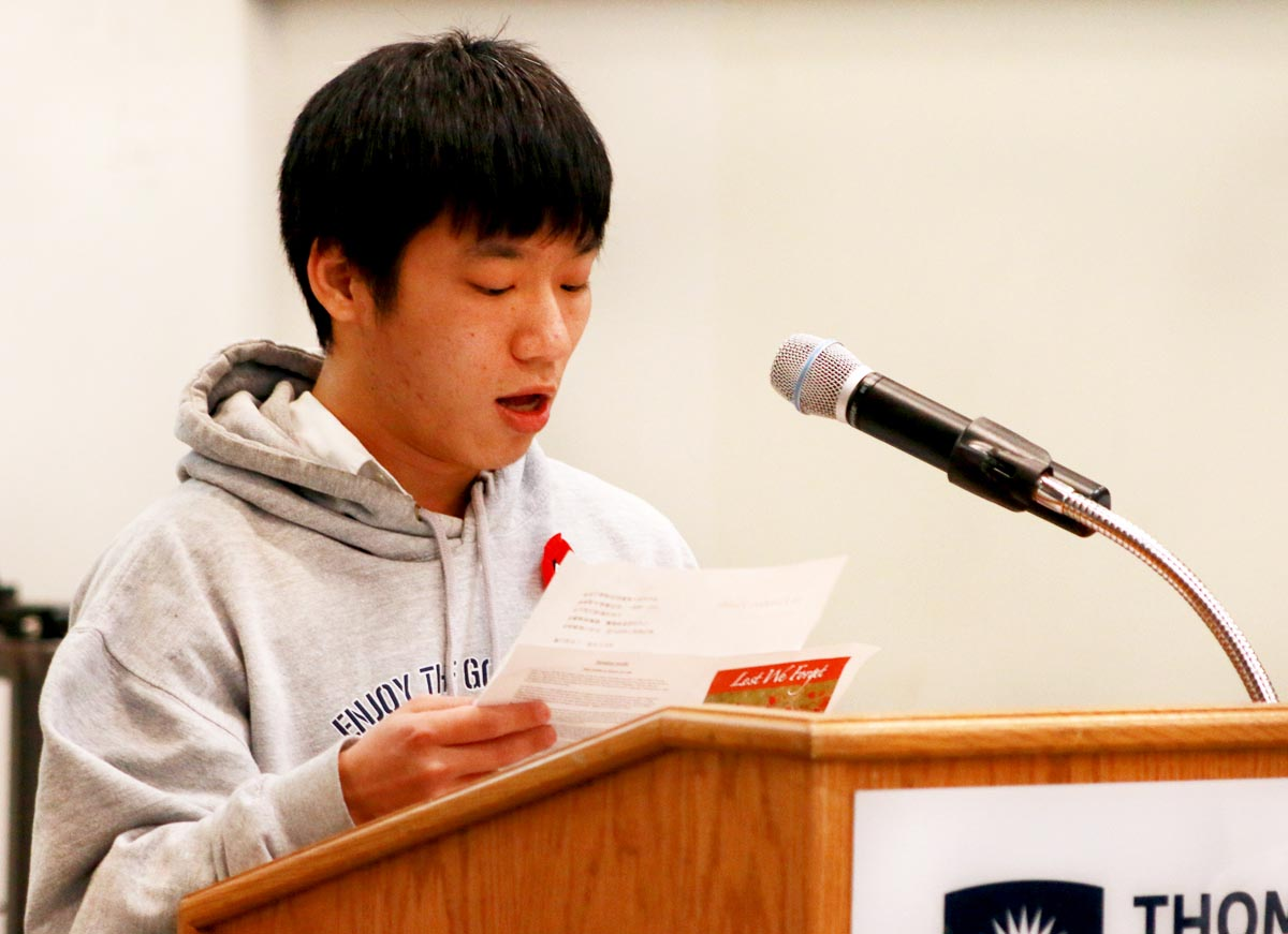 Master of Education student Paul Hu reads the poem In Flanders Fields.