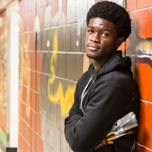 Idiamin Rayneil Mckinney, mural artist and first-year Bachelor of Science student