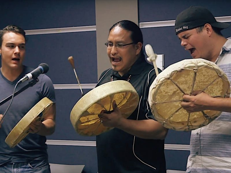 Vernie Clement, (centre) Indigenous mentor and community coordinator, drumming with students Ryan Oliverius (left) and Justin Young
