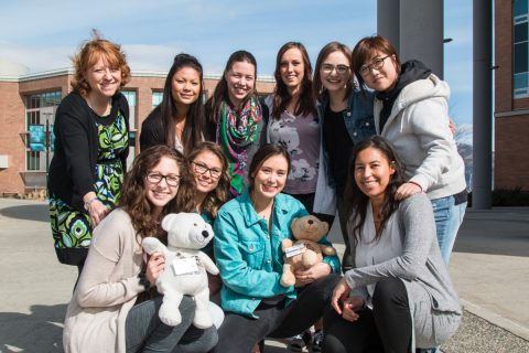 Students ready to depart in May along with School of Nursing adopted bears <i>Kenkeknem</i> and <i>Ckenmim'elt</i>.
