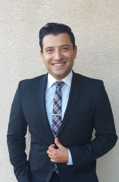 Milad Javdan, TRU Law alumnus and co-author, in business attire