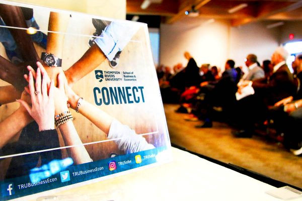 School of Business Connect poster on a table top