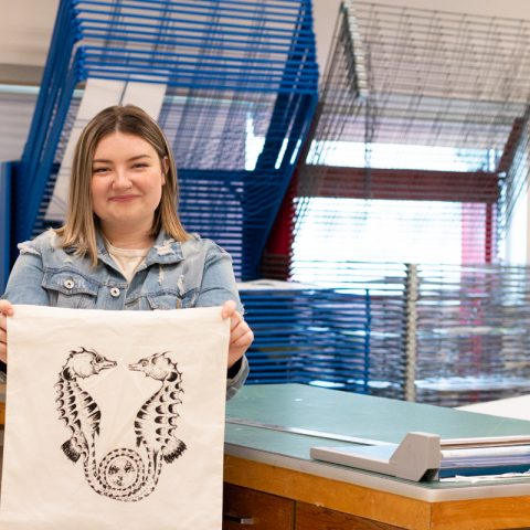 Kiera Duffy with her design screen printed on a canvas tote bag.