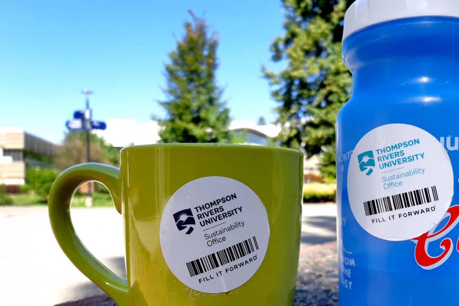 Mug and bottle with Fill It Forward stickers