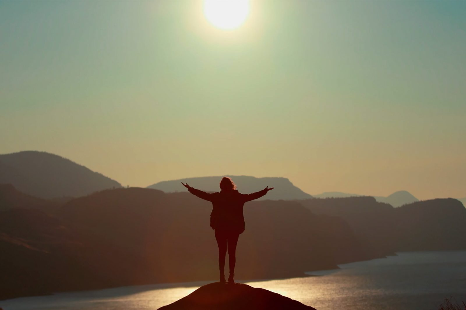 person standing on a mountain top