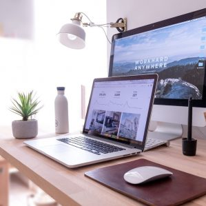 image of desk with two computer screens