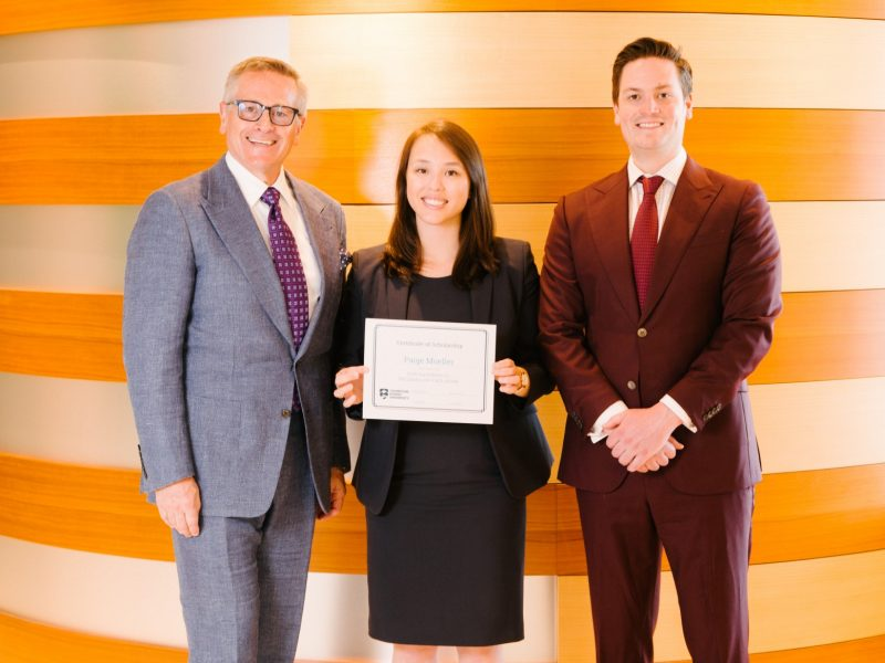 Donor presents scholarship to TRU Law student.