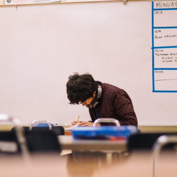 person studying alone in a classroom