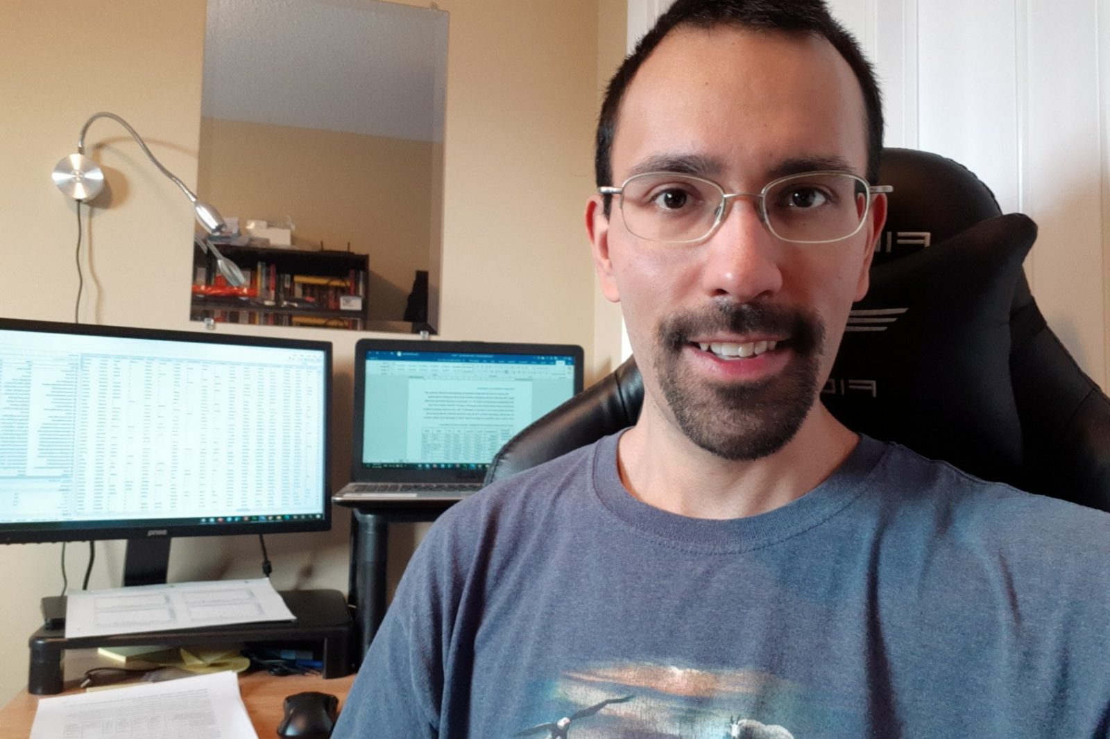 Shawn Blankinship working with statistics related to Indigenous governance